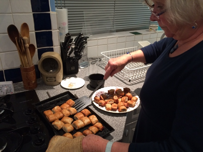 Woman cooking sausage rolls