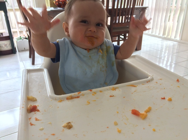 Baby with food all over