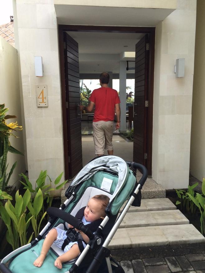 Baby in stroller outside villa