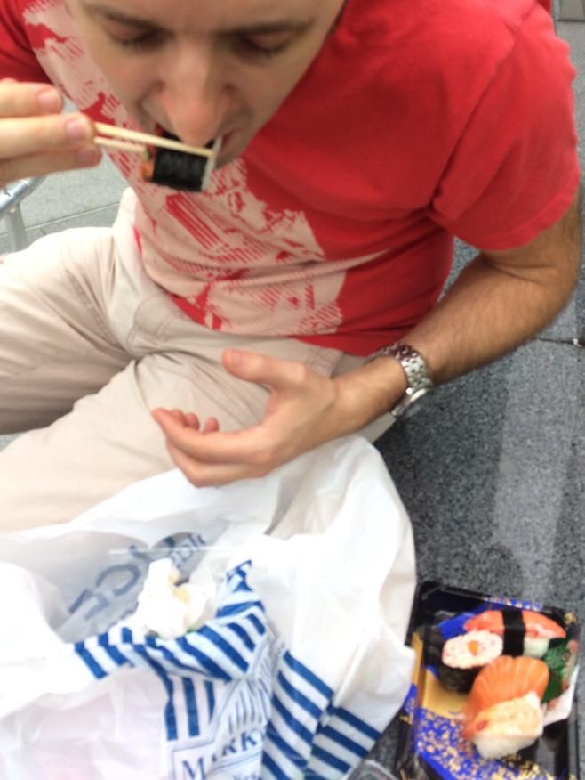 Man eating sushi