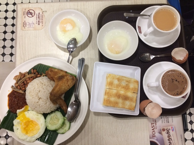 nasi goreng, kaya toast, half boiled eggs, sweet tea and milo