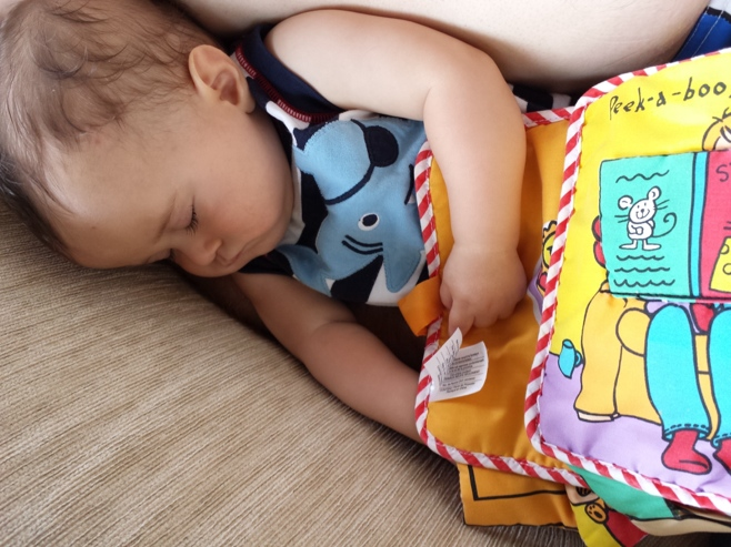 Baby napping with book