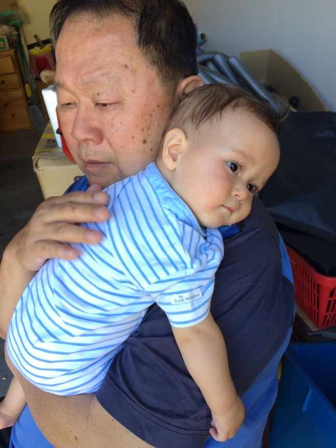 Baby resting on grandpas shoulder