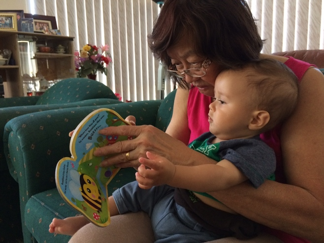 Grandma reading baby A Bumbelbee book