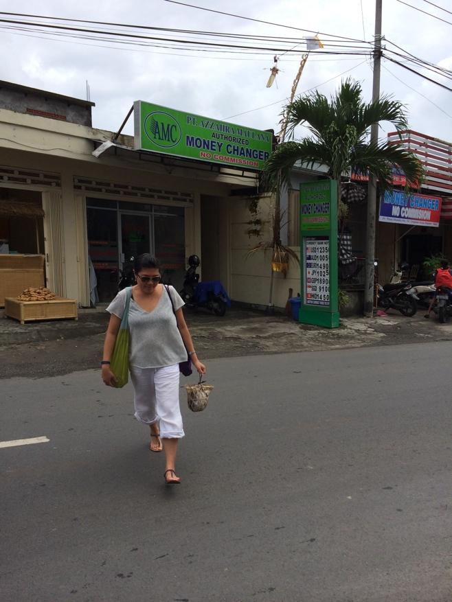 Woman crossing street in Bali