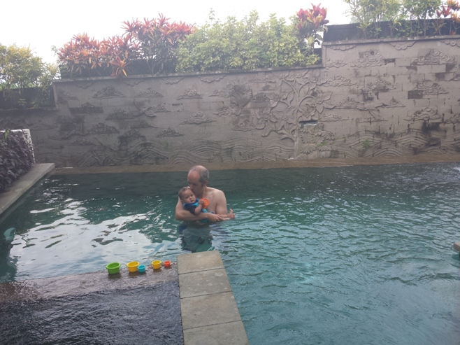 Man and baby in pool