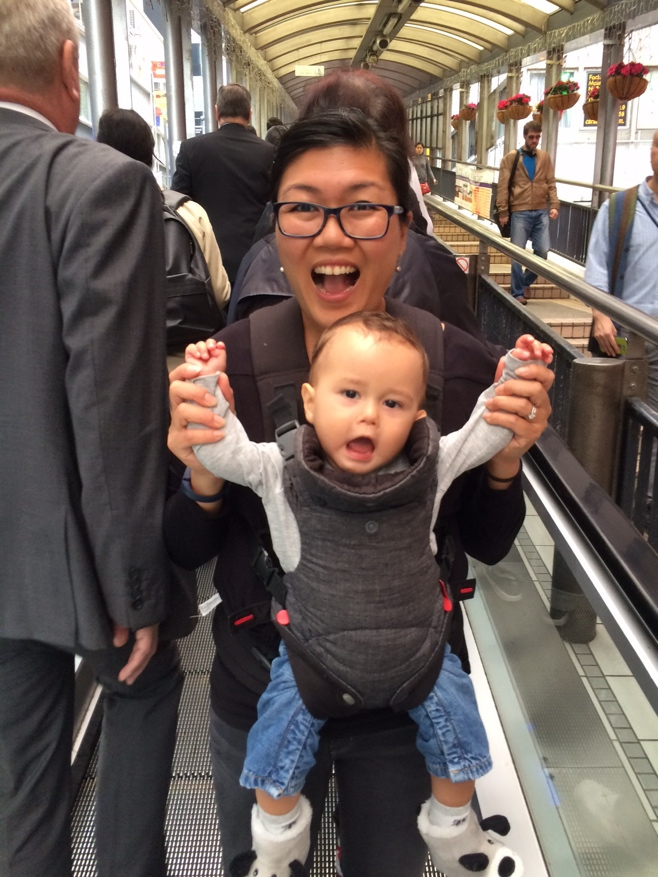 Mum and baby cheering on escalator on HK