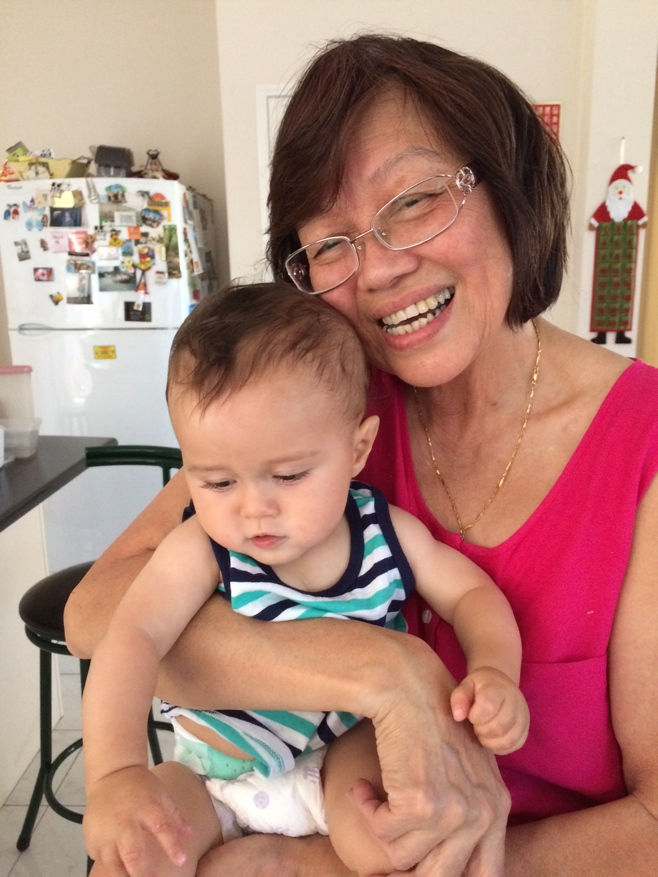 Grandma holding baby in stripped tank top