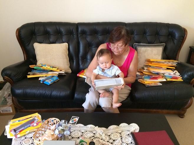 Grandma reading to baby