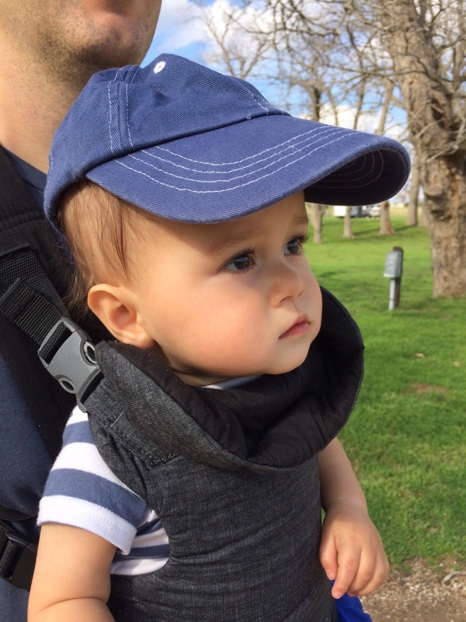 Cute baby wearing baseball cap