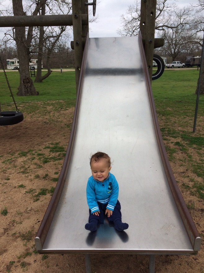 Baby sitting on slide