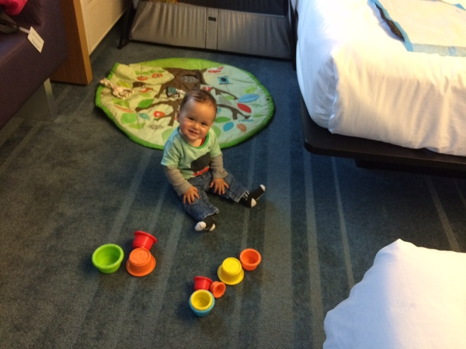 Baby playing in hotel room
