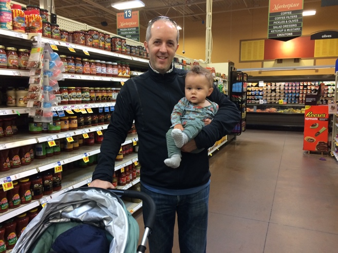 Man and baby in supermarket