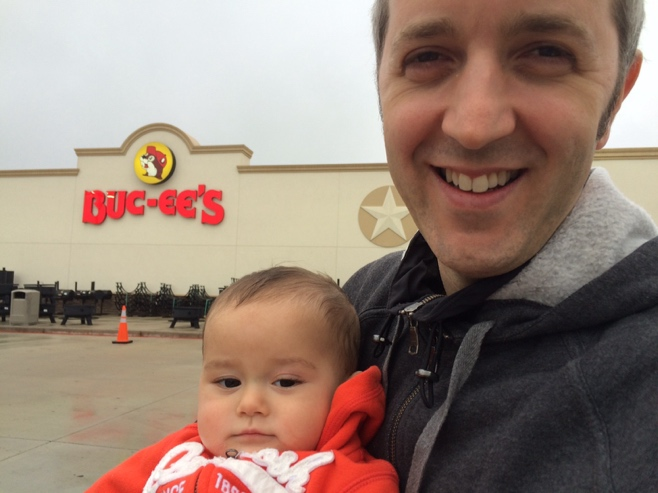 Man and baby at buc-ees