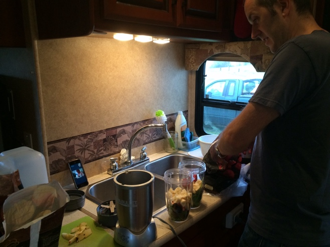 Man making green juice in RV