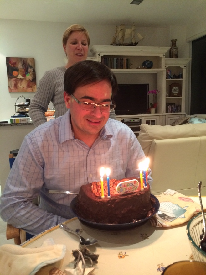 Man with birthday cake and six candles