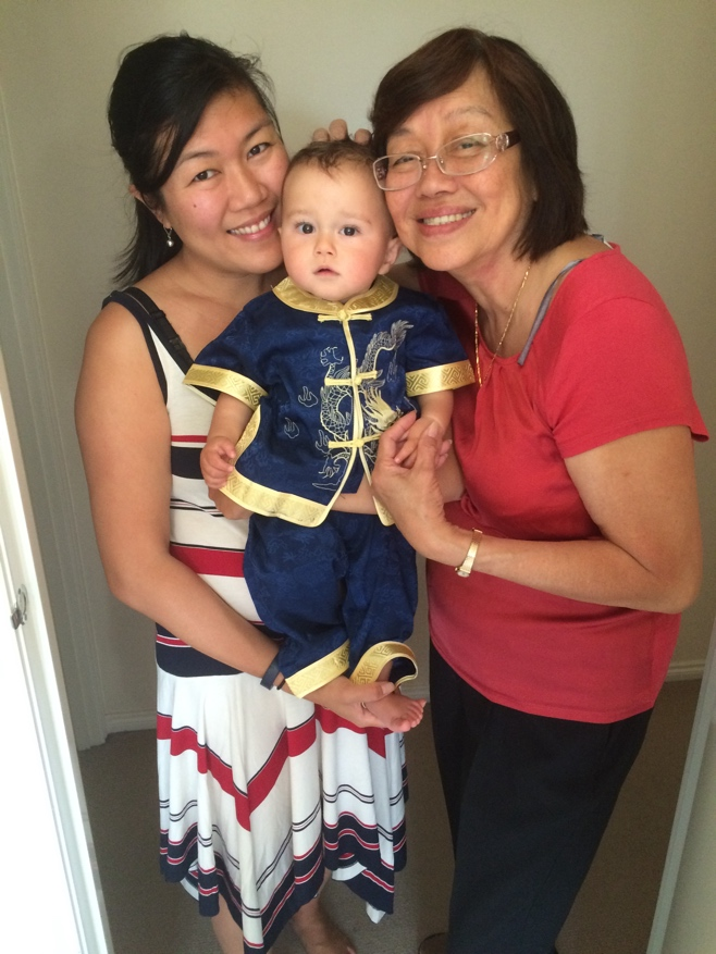 Mum grandma and baby in a chinese outfit