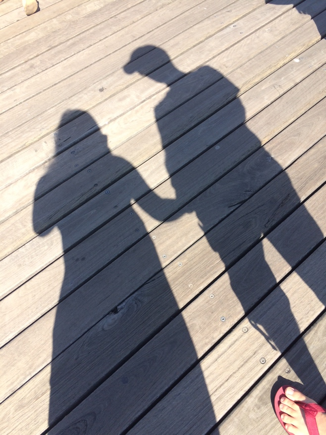 Shadow of a couple on a pier