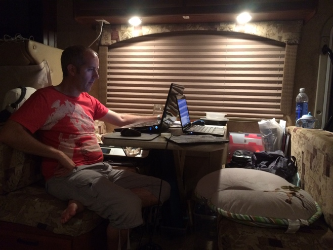 Man sitting infront of laptop in RV