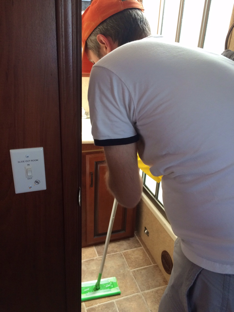 English hubby cleaning the RV bathroom