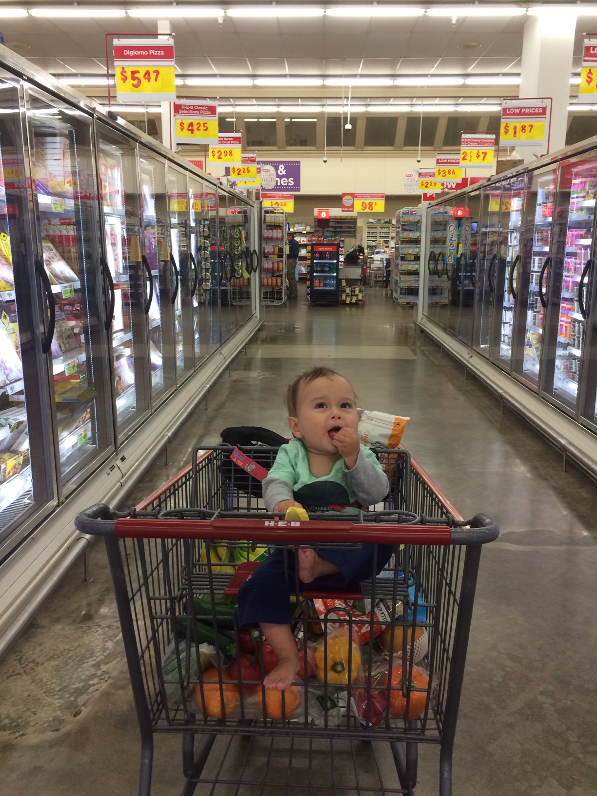 Baby boy o in cart in supermarket