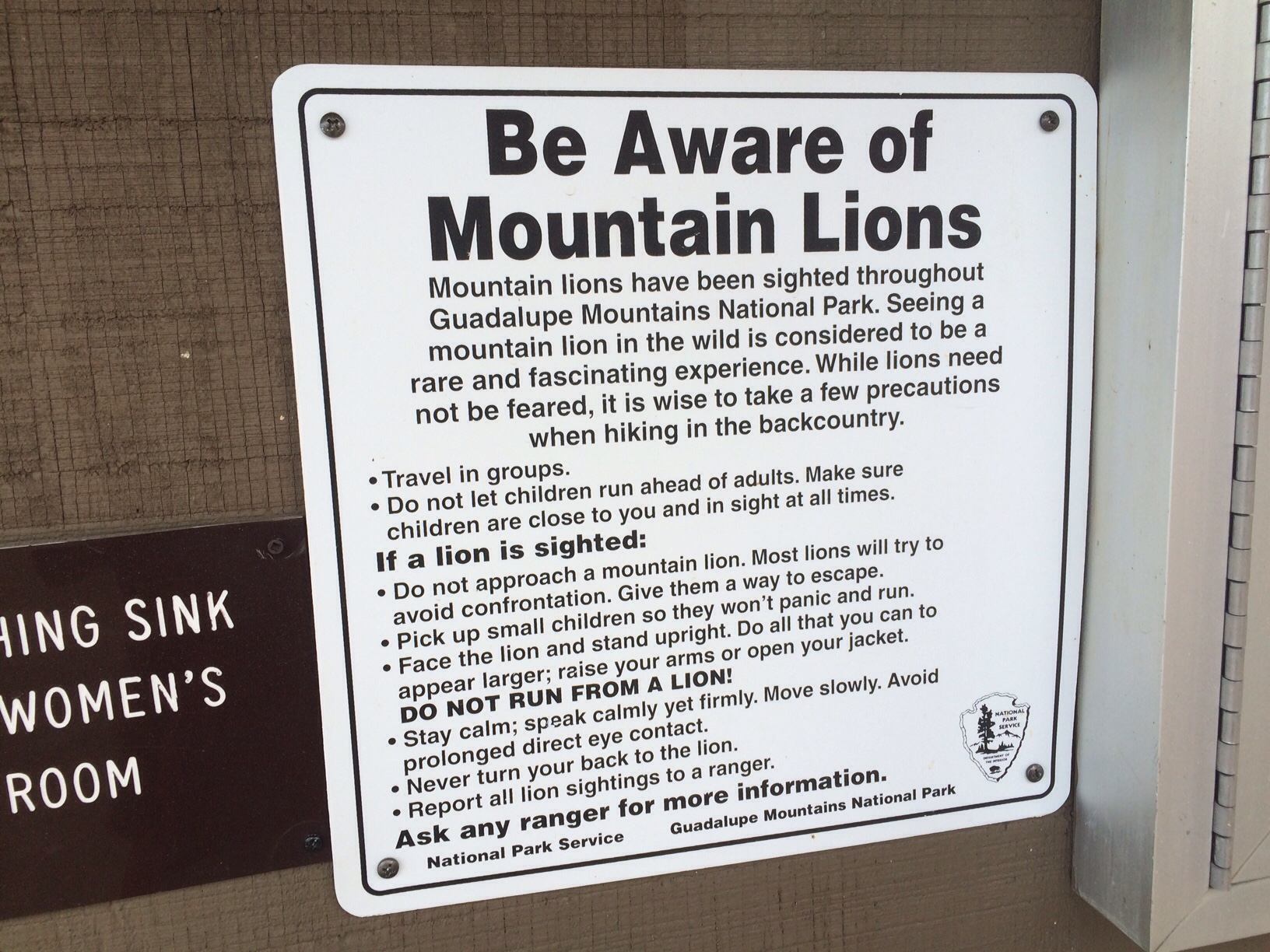 Beware of mountain lions sign