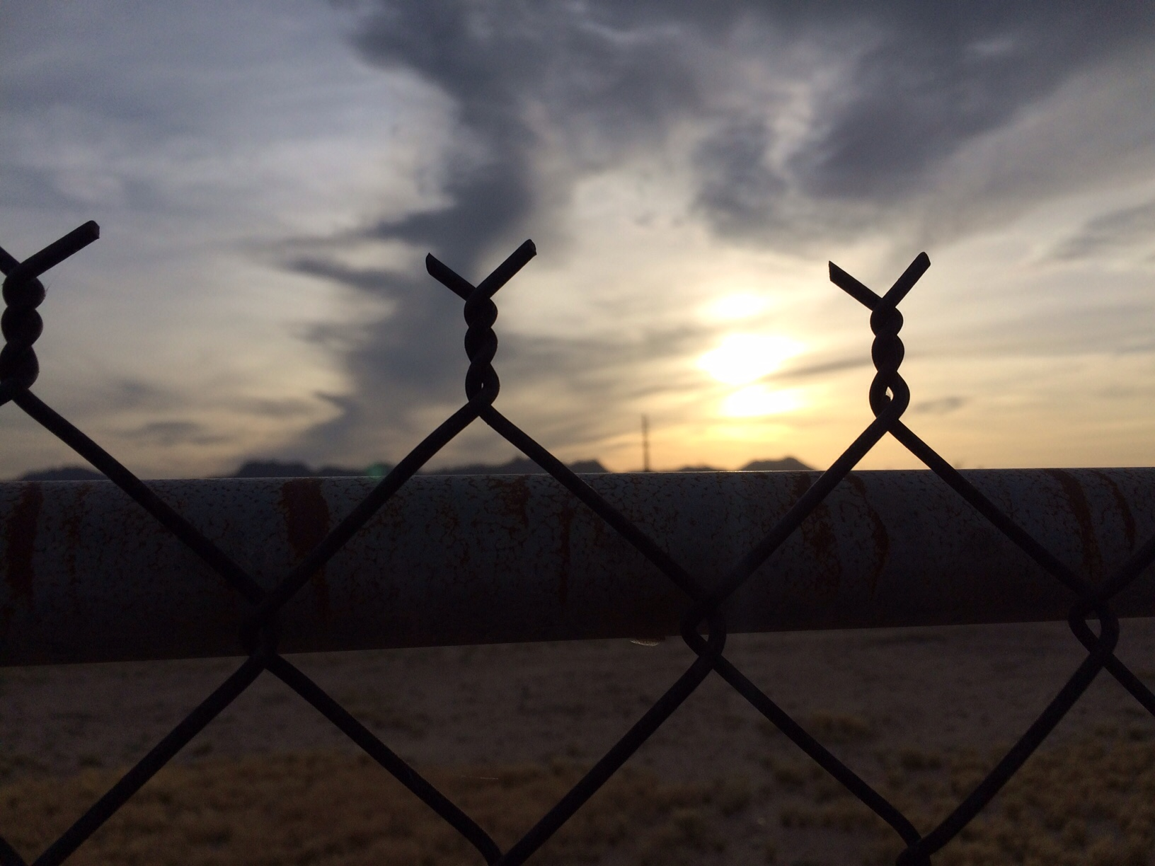 Sunset from barbed wire fence