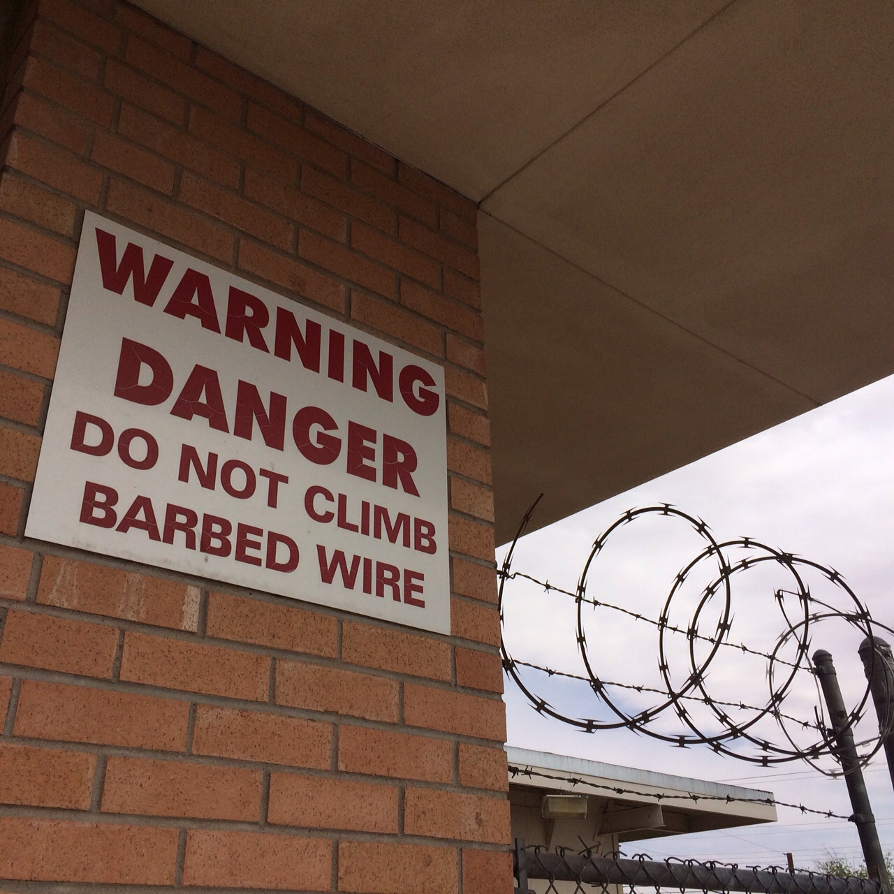 Warning sign for barb wire