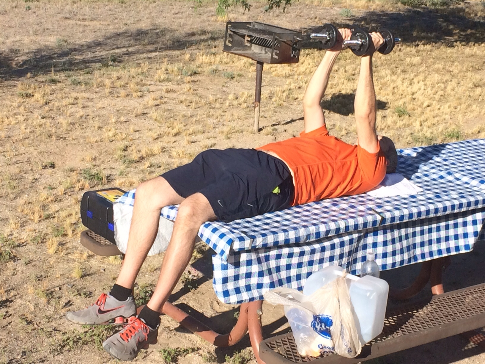 English hubby exercising on picnic table