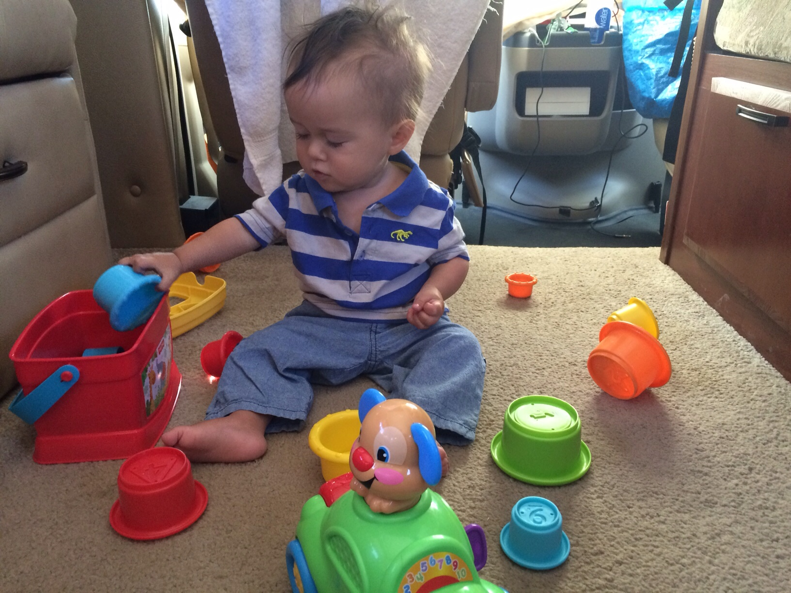 Baby boy o playing in RV with toys
