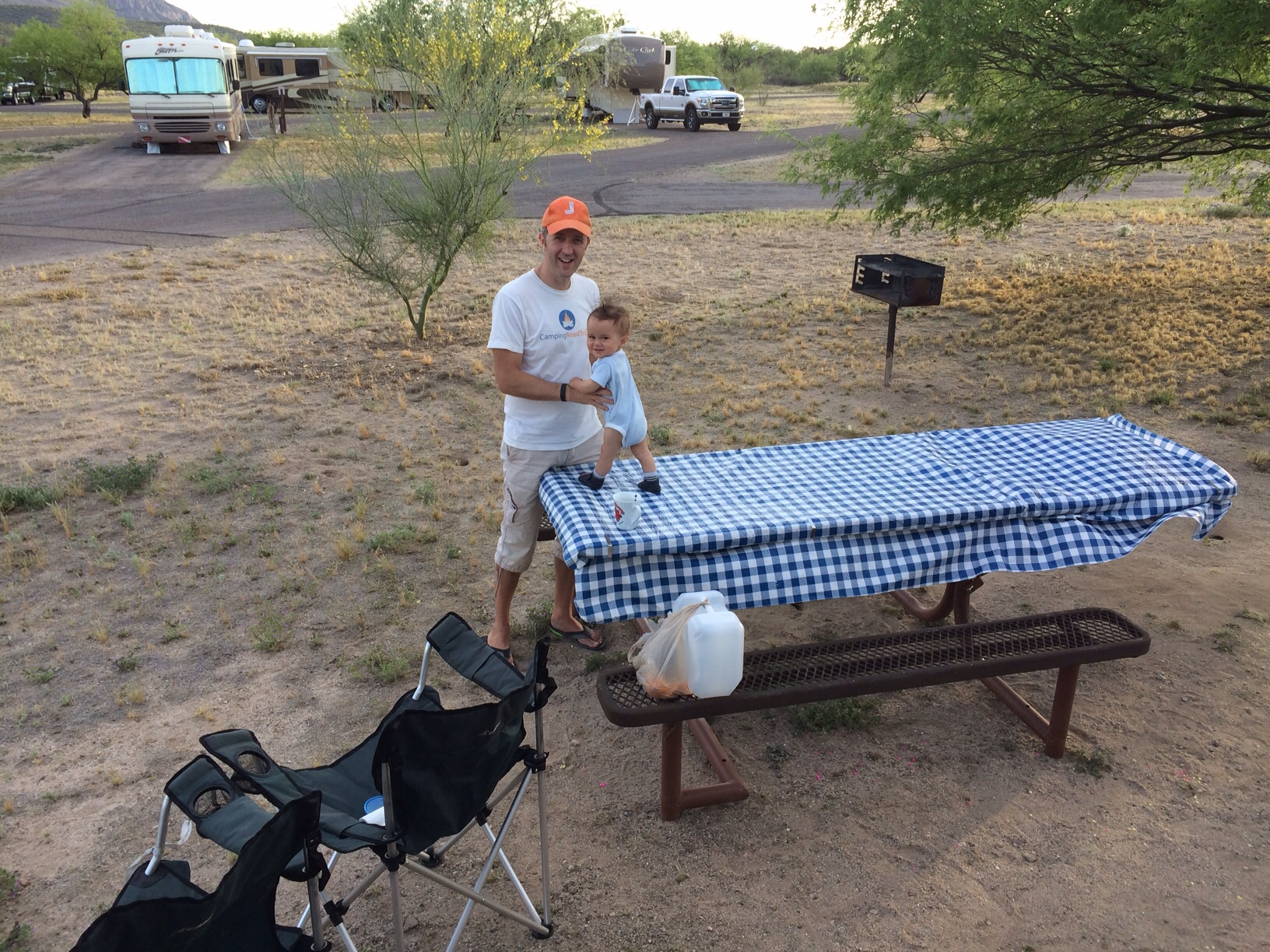 Baby boy O walking on picnic table