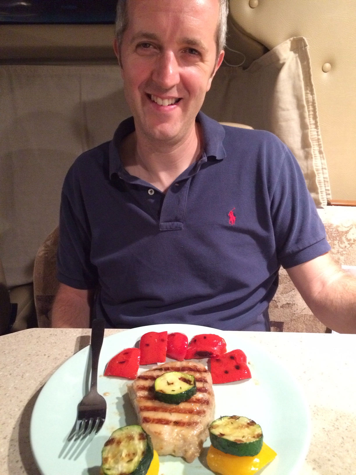 English hubby with happy face grilling