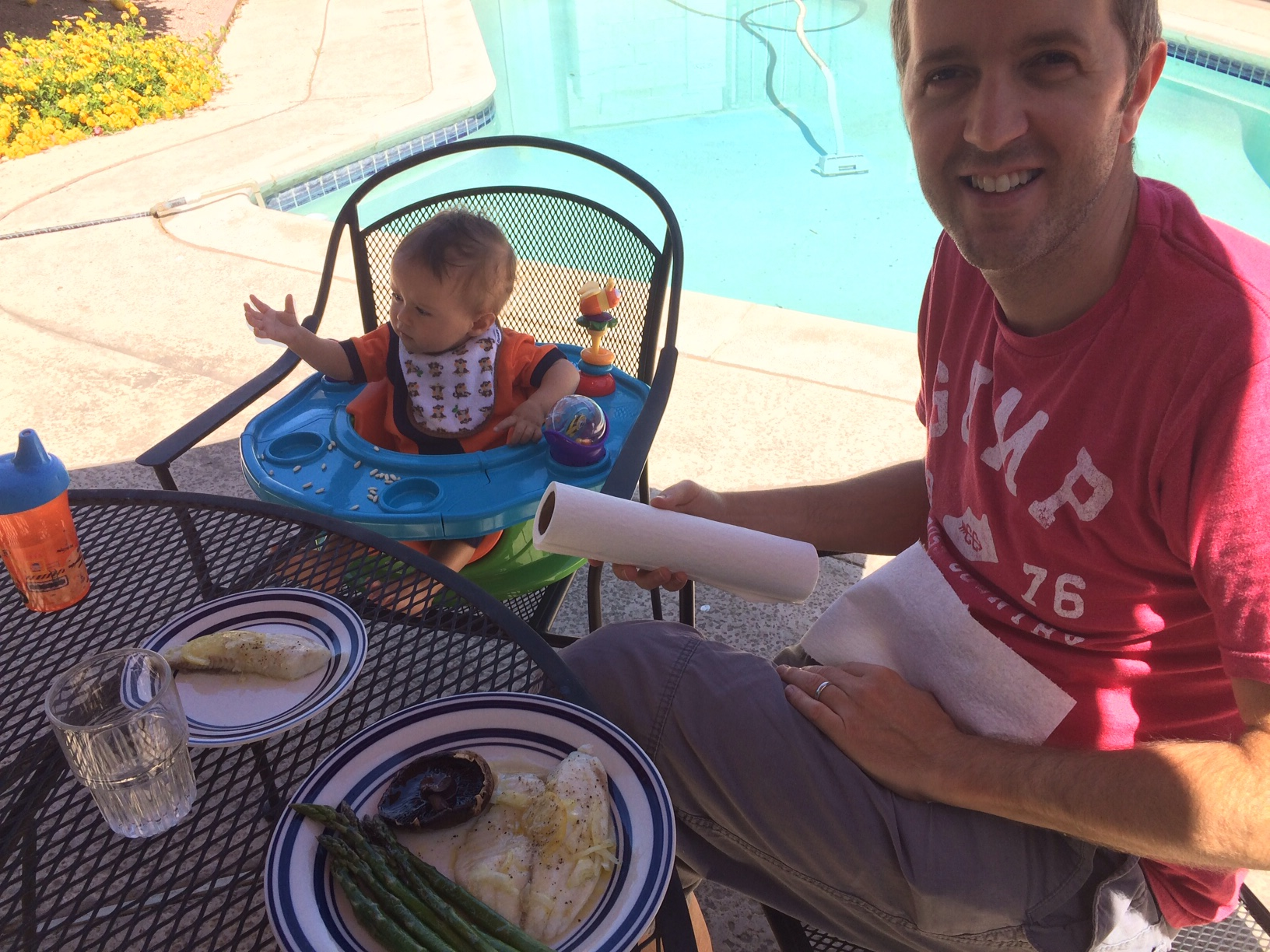 English hubby and Baby boy o having fish lunch by pool