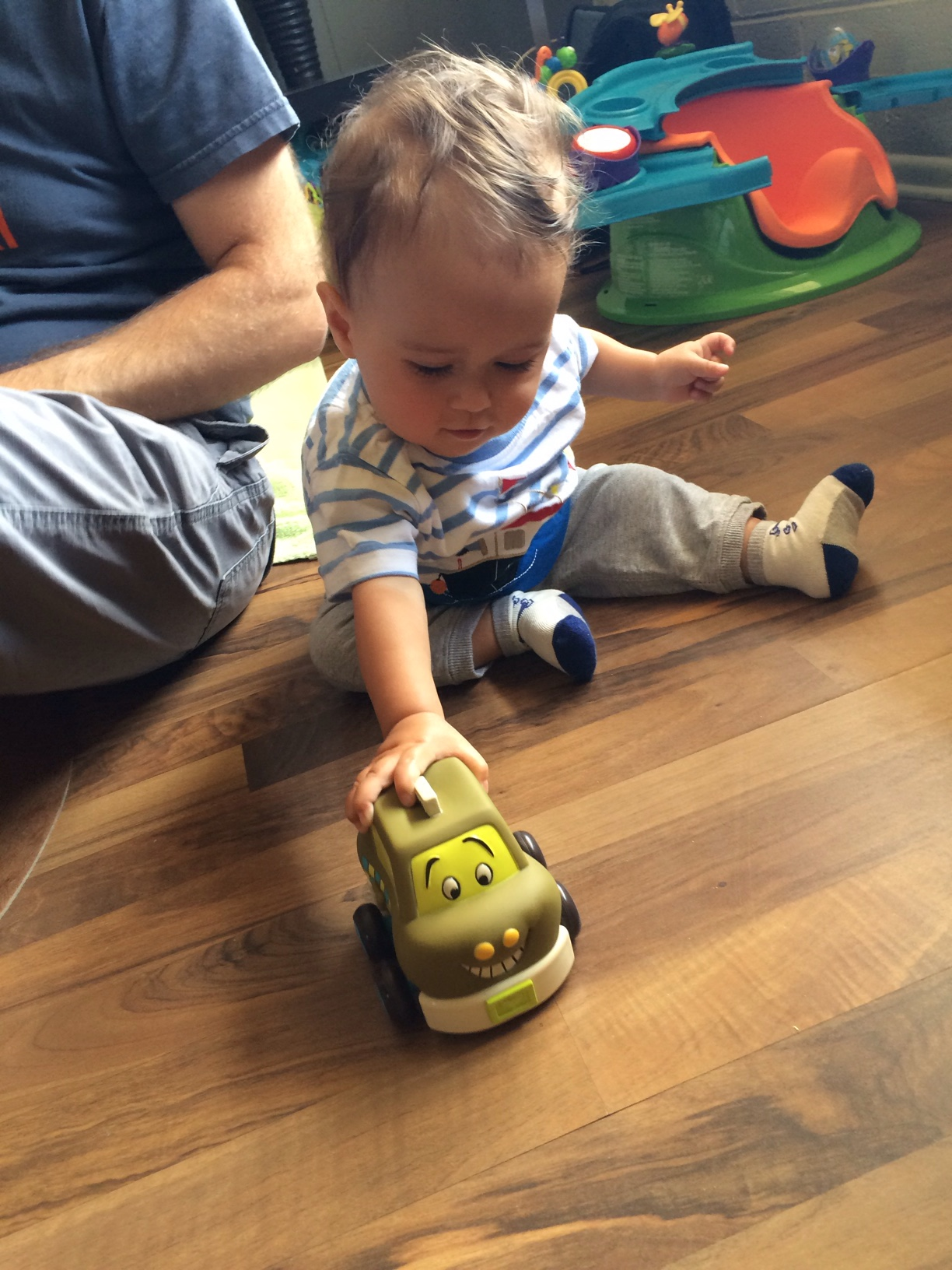 Baby boy o playing with toy car