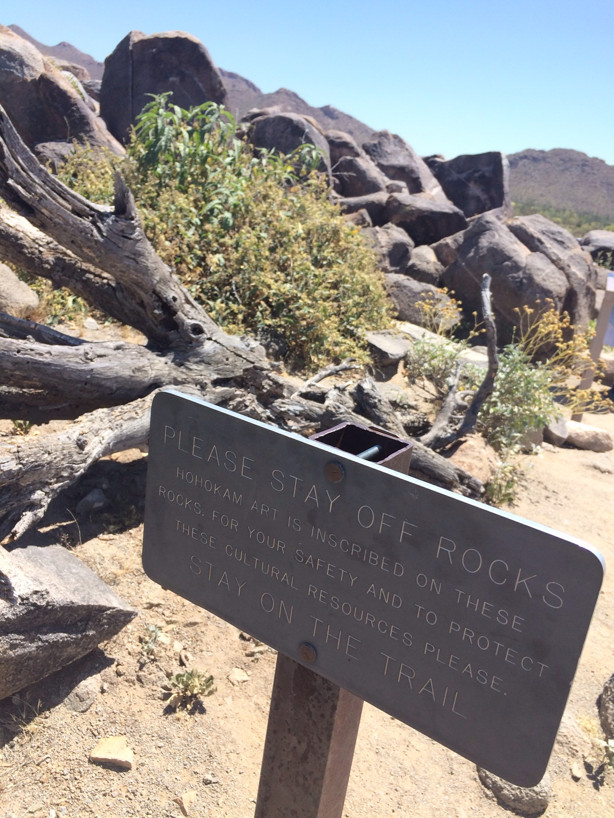 Stay off rocks sign