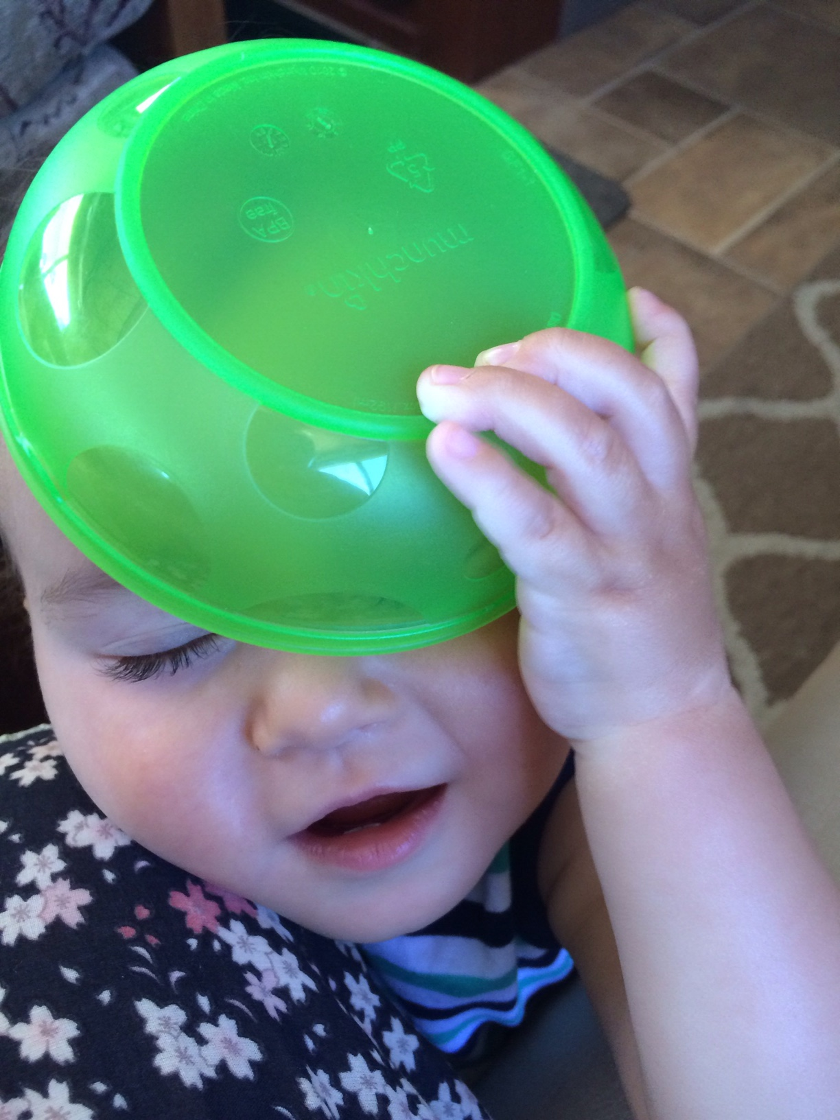 Baby boy O with green bowl on head
