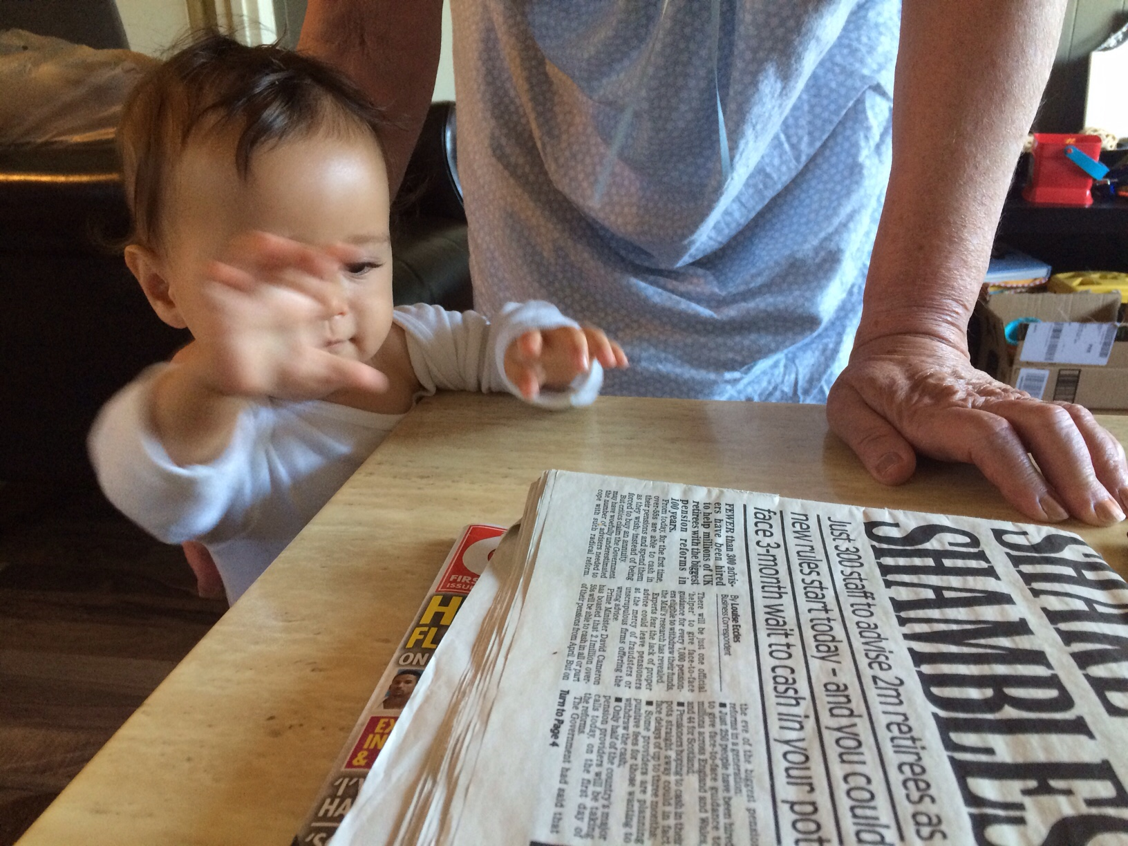 Grabbing newspapers