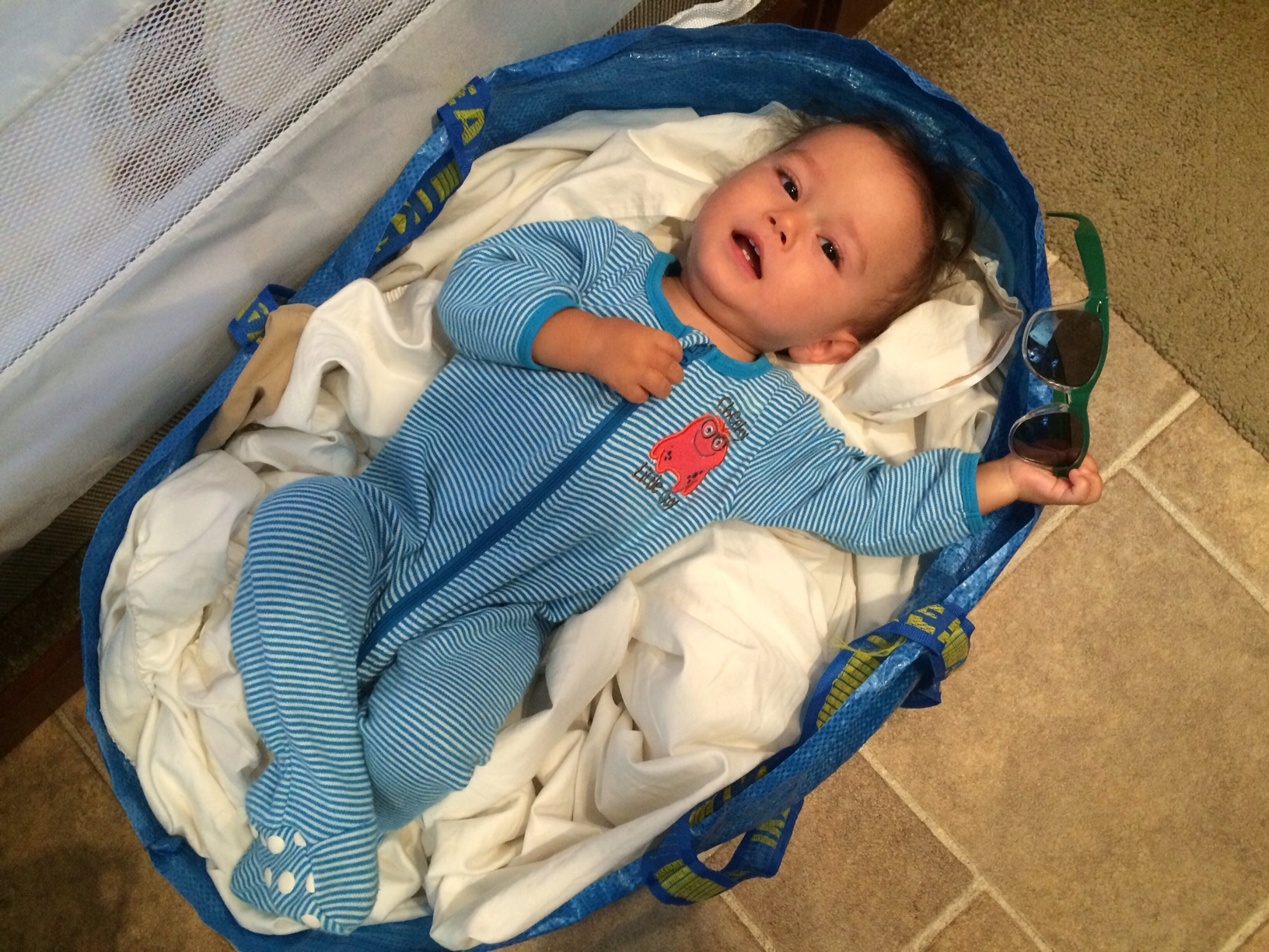 Baby boy o in laundry basket