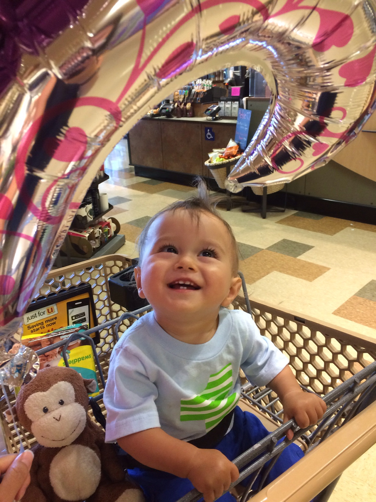 Baby boy o smiling at balloon