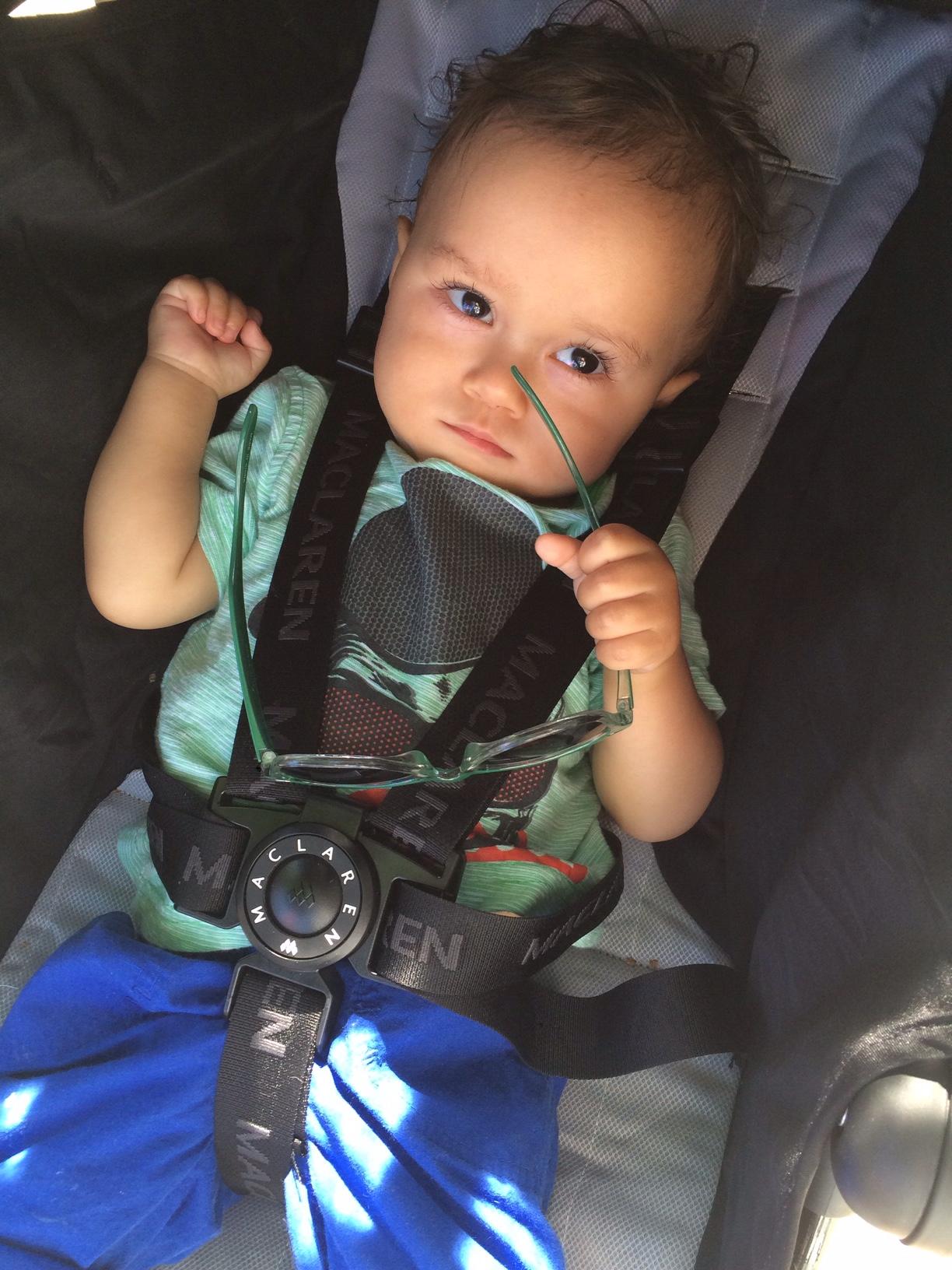 Grumpy holding sunglasses