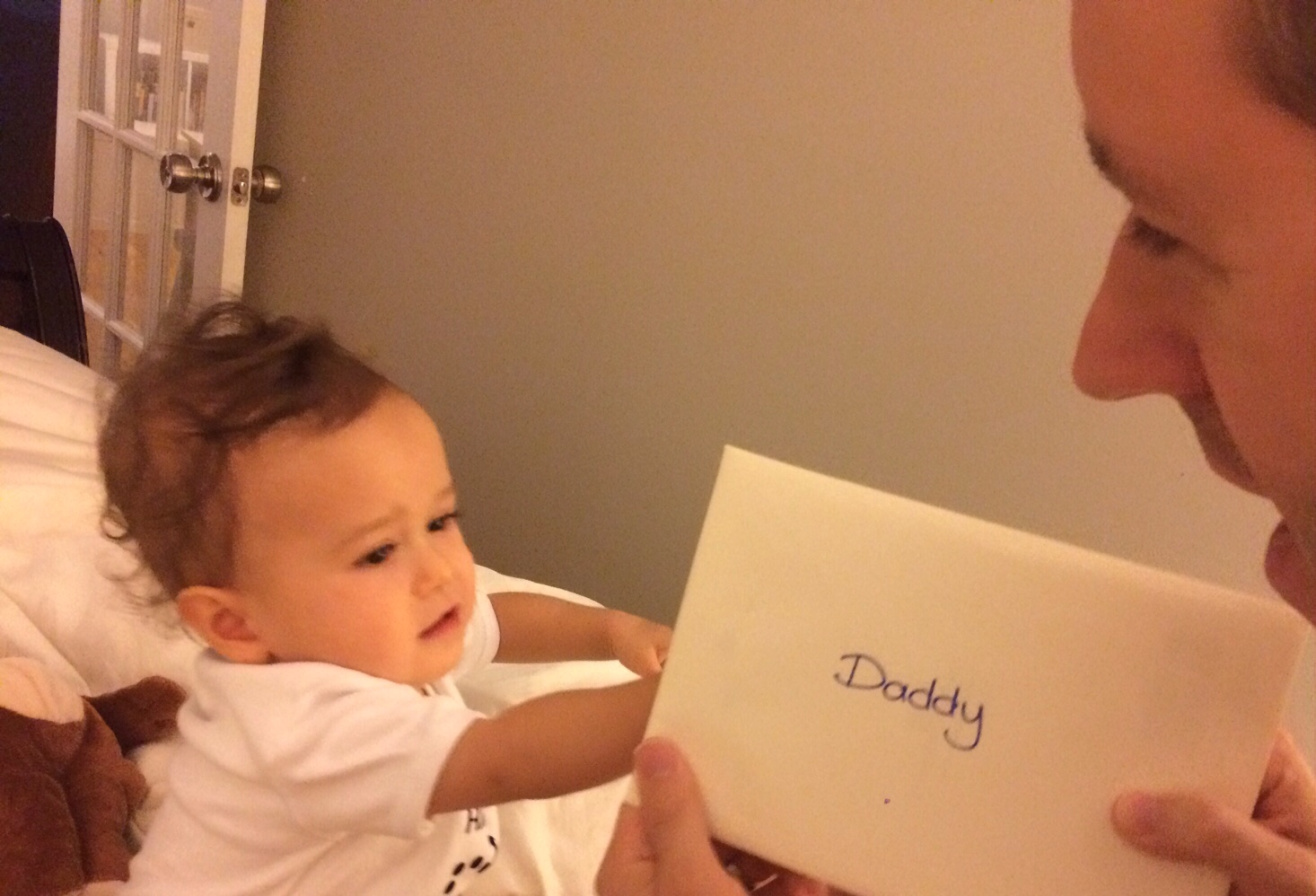 Baby giving card to dad