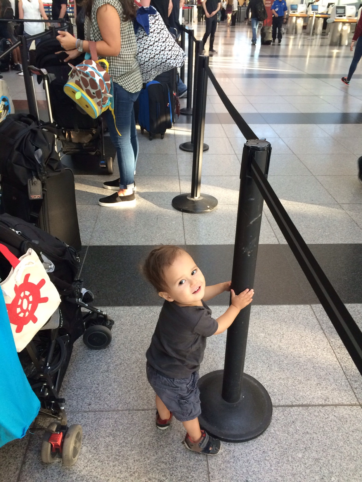 Baby boy o holding on to pole