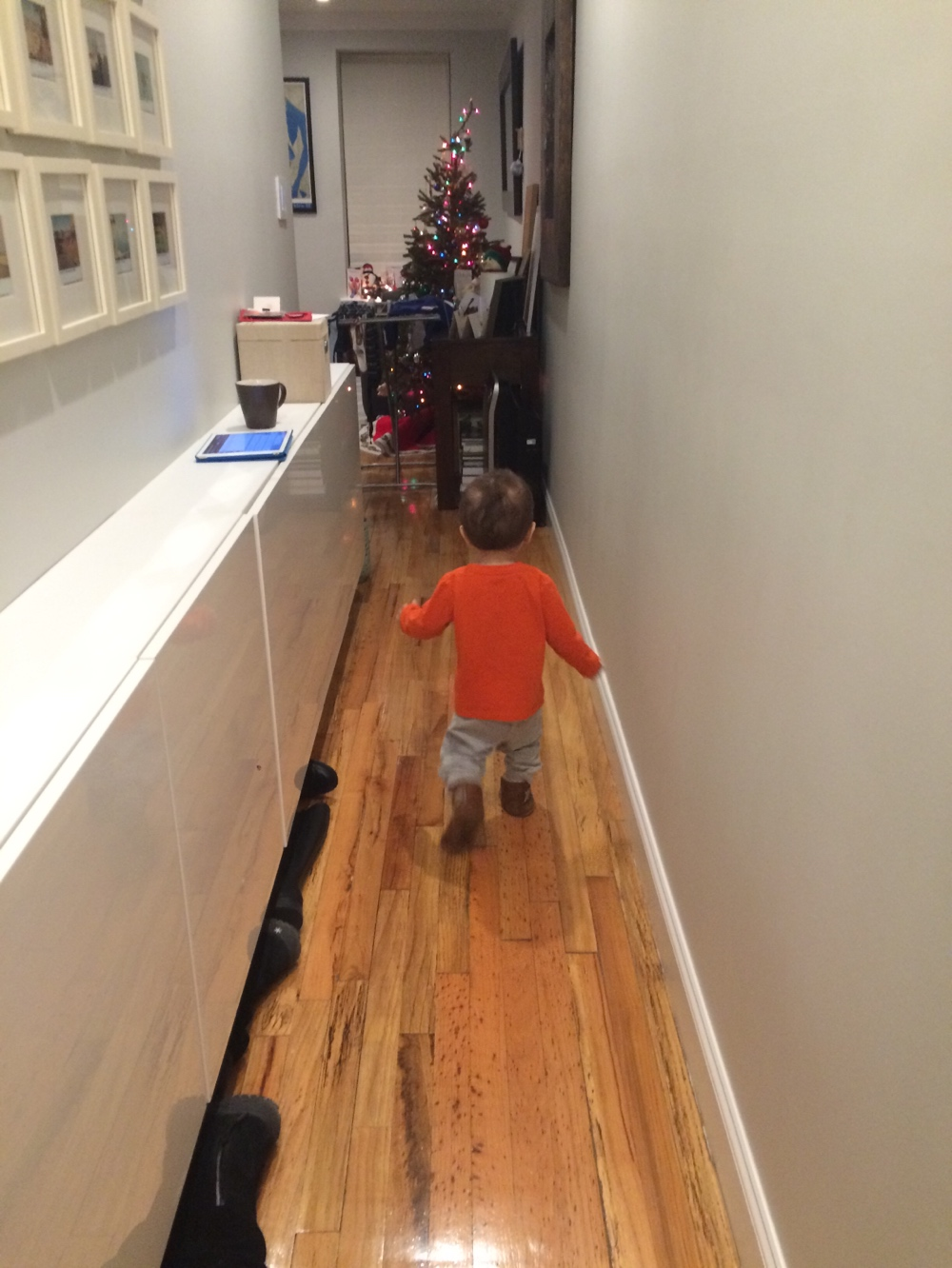 Baby walking down hallway