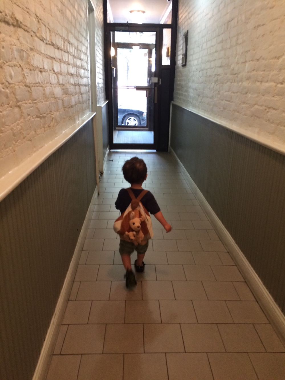 Toddler with roo bag on back